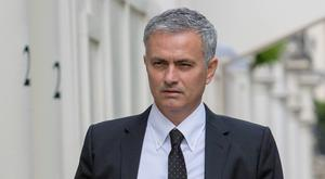 Football manager Jose Mourinho arrives back at his house in central London. PA