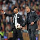 Old pals act: Pep Guardiola and Jose Mourinho will clash again next season, this time in charge of Manchester's rival clubs, City and United