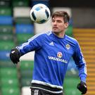 On the ball: Kyle Lafferty tunes up at Windsor Park for tonight's Belarus clash