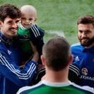 Northern Ireland's Kyle Lafferty (L) and Stuart Dallas (R) pose with fans before the international friendly game between Northern Ireland and Belarus on May 26, 2016 in Belfast, Northern Ireland. (Photo by Charles McQuillan/Getty Images)
