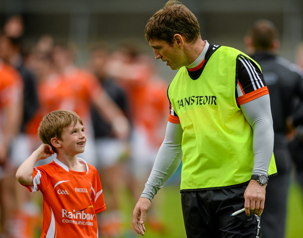 Born to lead: Kieran McGeeney is often portrayed a hard-nosed nononsense football man but having children, including little Cain, has changed his outlook on life