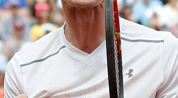Delighted: Andy Murray celebrates after defeating Ivo Karlovic at the French Open