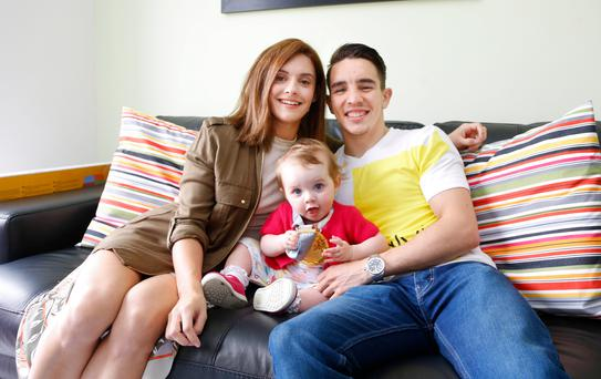 Boxing star Michael Conlan relaxes at home with his fiancee Shauna and their young daughter Luisne