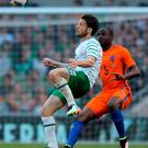 Republic of Ireland's Harry Arter (L) in action against Netherlands' defender Jetro Willems during the friendly football match between Ireland and the Netherlands at the Aviva Stadium in Dublin, Ireland, on May 27, 2016. / AFP PHOTO / CAROLINE QUINNCAROLINE QUINN/AFP/Getty Images