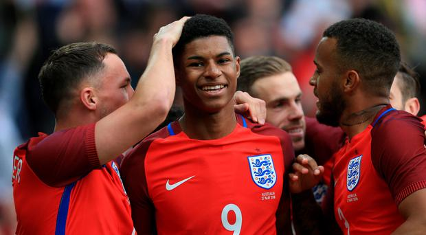 Top Marc: Marcus Rashford gets a pat on the head from England team mate Danny Drinkwater after scoring two minutes into his international debut