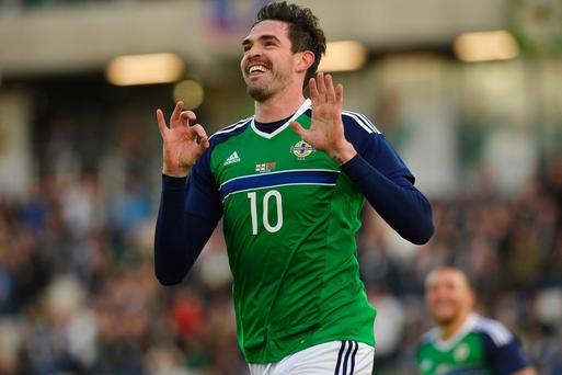 Goal hero: Northern Ireland's Kyle Lafferty celebrates last night