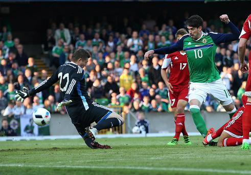 Windsor wonder: Kyle Lafferty scores Northern Ireland's first goal against Belarus last night