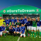 On our way: Northern Ireland's players were given a rousing send-off by the fans last night