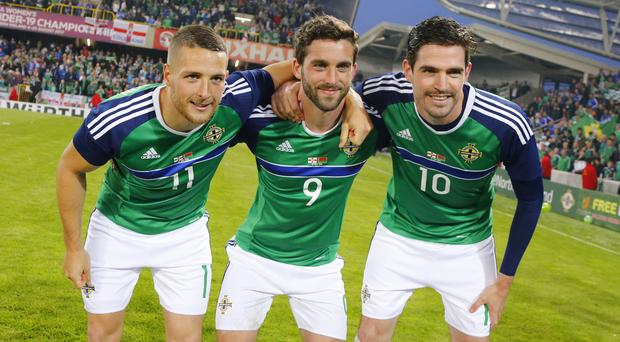 Goals galore: Northern Ireland's goalscoring trio Conor Washington, Will Grigg and Kyle Lafferty at Windsor Park last night