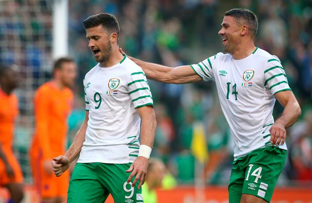Long night: Shane Long wheels away in celebration after putting the Republic of Ireland in front in their pre-Euro 2016 friendly with Holland at the Aviva Stadium