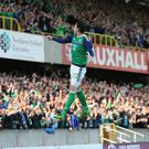 Hitting the heights: Northern Ireland striker Kyle Lafferty celebrates scoring the opener in the 3-0 win against Belarus, his 17th goal in 50 caps