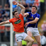Aerial battle: Armagh's Ciaran O'Hanlon and Tomas Corr of Cavan battle for possession