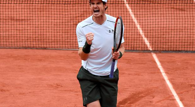 I feel good: Andy Murray celebrates victory over John Isner yesterday