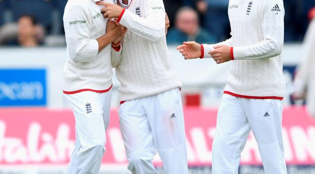 Go Joe: England's Joe Root celebrates with captain Alastair Cook (left) and James Anderson (right) after catching out Sri Lanka's Dimuth Karunaratne
