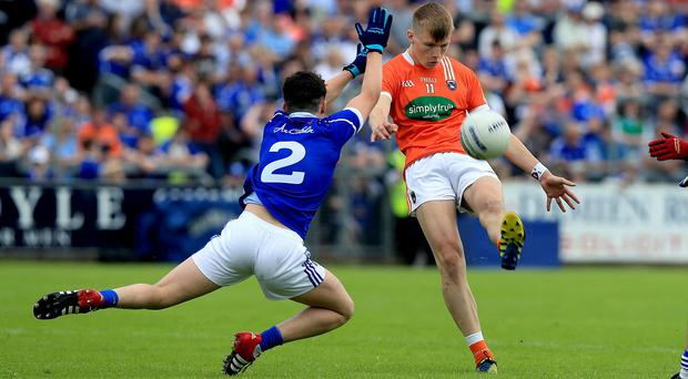 Rising star: Rian O'Neill shows his class against Cavan yesterday