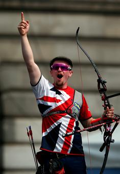 Bang on target: Patrick Huston celebrates yesterday in Nottingham