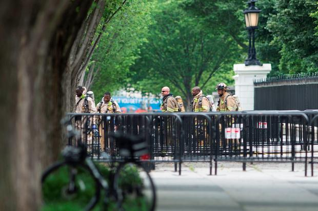 Firefighters leave the Northeast gate to the White House on Pennsylvania Avenue during a security lockdown of the White House grounds May 30, 2016 in Washington, DC. / AFP PHOTO / Brendan SmialowskiBRENDAN SMIALOWSKI/AFP/Getty Images