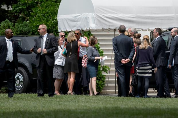 US President Barack Obama(C) talks with guests after retiring to the White House from a visit to Arlington National Cemetery May 30, 2016 in Washington, DC. / AFP PHOTO / Brendan SmialowskiBRENDAN SMIALOWSKI/AFP/Getty Images