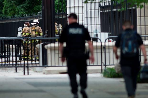Firefighters stand by the Northeast gate to the White House as Secret Service members walk along Pennsylvania Avenue during a security lockdown of the White House grounds May 30, 2016 in Washington, DC. / AFP PHOTO / Brendan SmialowskiBRENDAN SMIALOWSKI/AFP/Getty Images