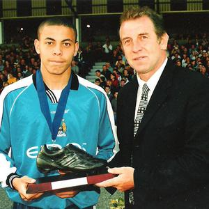 Shooting stars: Gerry Armstrong presents the Golden Boot to Dorryl Proffit of Manchester City at the Milk Cup back in 2000