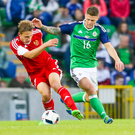 Watchful eye: Northern Ireland star Oliver Norwood puts the pressure on Belarus after coming off the bench in the 3-0 triumph at Windsor Parkwood