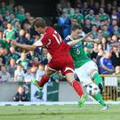 Kicking on: Chris Baird, pictured playing against Belarus at Windsor, says he always had the belief Northern Ireland could qualifying for a major finals