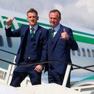 Captain Steven Davis manager Michael O'Neill board the plane for Euro 2016