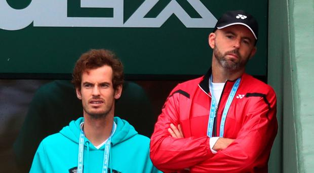 Frustration: Andy Murray looks on at the French downpour