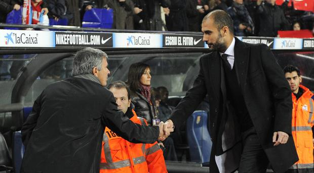 Old rivals: Jose Mourinho and Pep Guardiola have clashed in the past during their respective reigns at Real Madrid and Barcelona