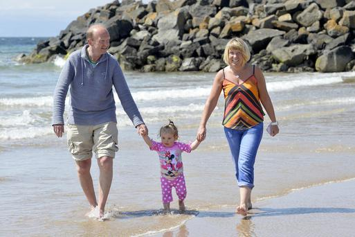 Les and Debbie Smith with grandaughter Holly aged 19 months from Ballyclare enjoy the sun