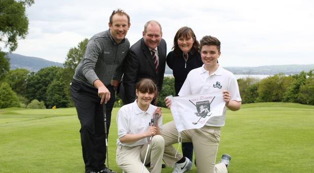 Green for go: Rockport pupils Stephen McCalmont (15) and Jessica Kelly (12), Debbie Hanna, PGA Professional at Blackwood Golf Club, and Stephen Crooks, PGA Professional at Holywood Golf Club, launch the new academy
