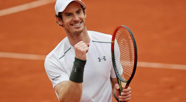 Britain's Andy Murray celebrates winning the quarterfinal match of the French Open tennis tournament against France's Richard Gasquet at the Roland Garros stadium in Paris, France, Wednesday, June 1, 2016. (AP Photo/Michel Euler)