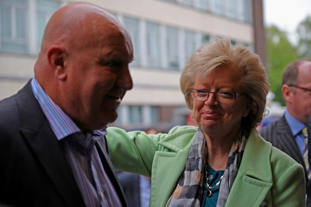 Julie Hambleton, sister of Birmingham pub bombings victim Maxine Hambleton and Paul Thrupp, son of victim Trevor Thrupp, react outside Solihull Civic Suite on June 1, 2016 in Birmingham, England. (Photo by Christopher Furlong/Getty Images)