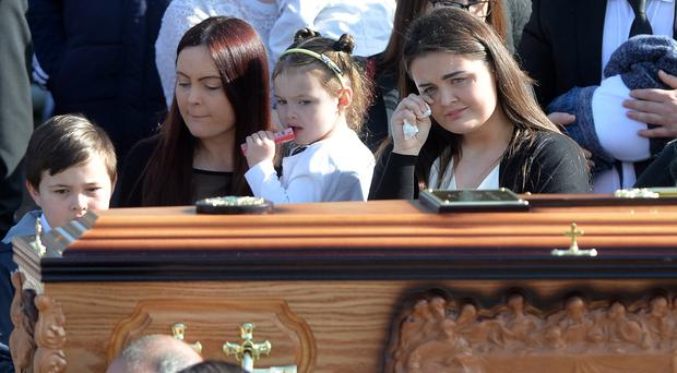 The funeral of Michael McGibbon who was shot in the Elmfield Street area of Ardoyne, close to the home he shared with his wife Joanne