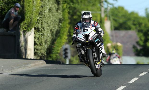 Fast mover: Michael Dunlop, riding a Hawk Racing BMW, produces a blistering lap of 131.574mph at last night's practice session for the Isle of Man TT