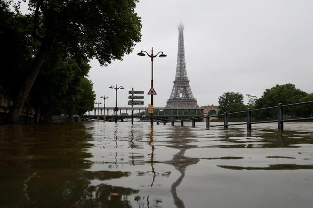 A picture taken on June 2, 2016 shows the river Seine bursting its banks next to the Eiffel Tower in Paris. AFP/Getty Images