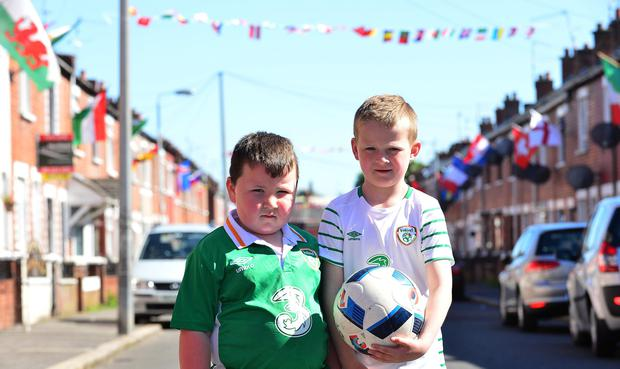 A Northern Ireland flag is not the most common sight on west Belfast's Springfield Road. But it is one of many flying proudly on one street ahead of the Euro 2016 football tournament. Picture By: Arthur Allison/ Pacemaker Press