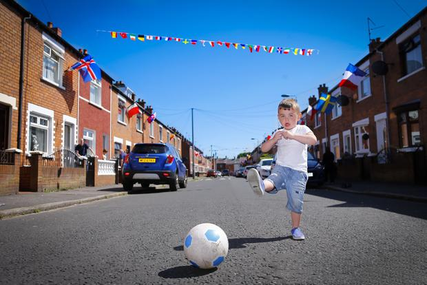 Mason Lennon (3) amid Flags for the Euros on Iris Drive on June 02 2016 in Belfast , Northern Ireland ( Photo by Kevin Scott / Belfast Telegraph)
