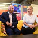 Rainbow Project director John O'Doherty with Health Minister Michelle O'Neill