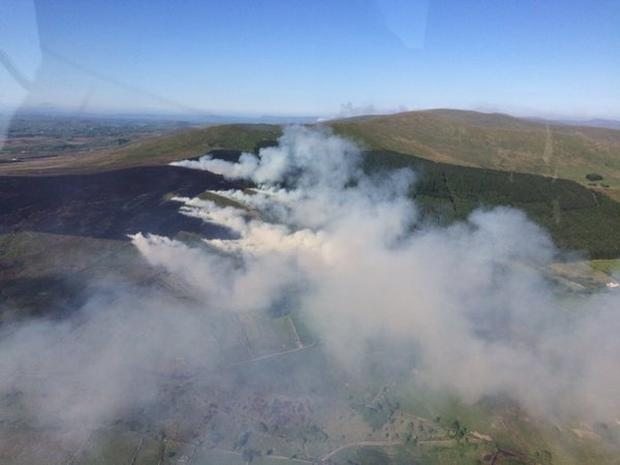 Stroanback gorse fire: Fire crews are battling two mile fire front in the area. PSNI air support are assisting. Photo: PSNI