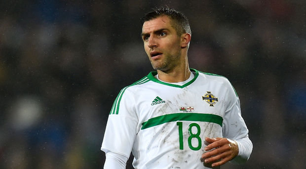 Ton up: Aaron Hughes' Northern Ireland career is set to come full circle as he is likely to win his 100th cap against Slovakia, who he made his debut against in 1998