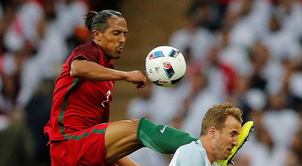 Ain't that a kick in the head: Bruno Alves commits red car offence on Harry Kane in England's 1-0 win over Portgual.