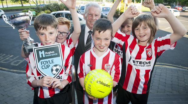 Up for the Cup: Johnny Giles launches the Foyle Cup in Londonderry with members of the Derry City Colts team