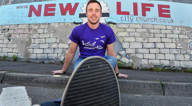 Peace walk: Tommy Bowe at a peace wall in west Belfast ahead of the Walk The Walls initiative tomorrow, organised by Active Communities Network