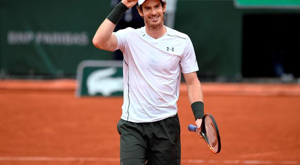Andy Murray celebrates after winning his men's semi-final match against Stanislas Wawrinka