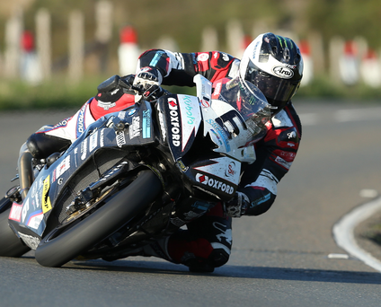 Leading the charge: Michael Dunlop sets a blistering pace at Isle of Man practice last night but Ian Hutchinson is too close for comfort