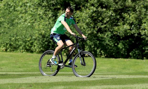 Pedal power: Robbie Keane rides a mountain bike as the Republic's physios carefully monitor the striker's recovery