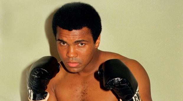 This is an Oct. 9, 1974, file photo showing Muhammad Ali. Ali, the magnificent heavyweight champion whose fast fists and irrepressible personality transcended sports and captivated the world, has died according to a statement released by his family Friday, June 3, 2016. He was 74. (AP Photo/Ross D. Franklin, File)(AP Photo/FIle)