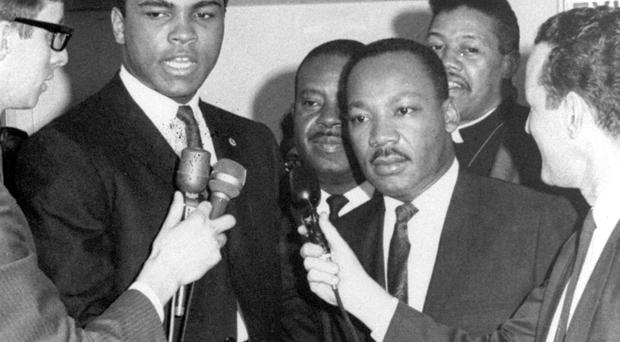 In this March 29, 1967, file photo, heavyweight champion Muhammad Ali, center left, and Dr. Martin Luther King speak to reporters. Ali, the magnificent heavyweight champion whose fast fists and irrepressible personality transcended sports and captivated the world, has died according to a statement released by his family Friday, June 3, 2016. He was 74. (AP Photo/File)