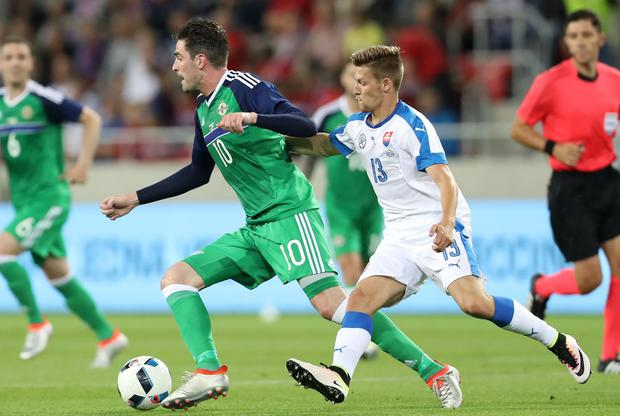 Press Eye - Belfast - Northern Ireland - 04th June 2016 - Photo by William Cherry Slovakia's Patrik Hrosovsky with Northern Ireland's Kyle Lafferty during Saturdays International Friendly at the City Arena, Trnava. The game friendly is Northern Ireland's final warm-up game before travelling to their Euro 2016 base camp in France.